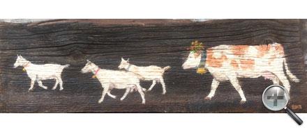 3 chèvres et une vache