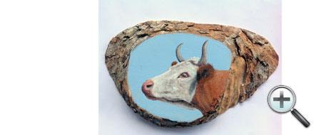Tête de vache sur bois