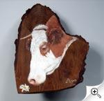 Portrait de vache sur bout de tronc